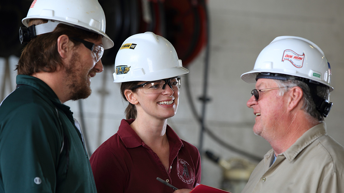Doe Run employees meet in maintenance shop as part of ISO certification process to improve environmental performance.
