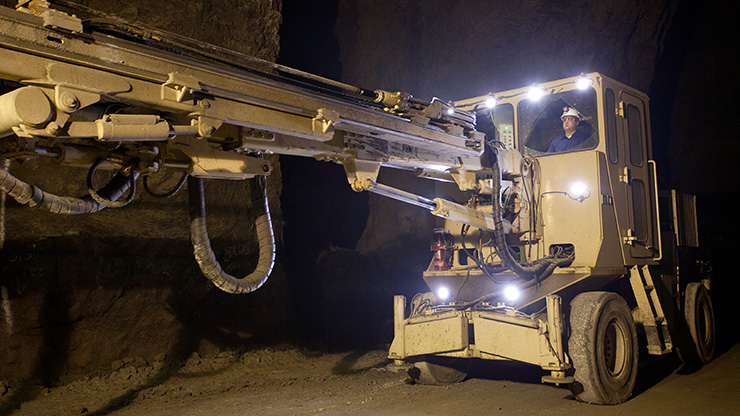 Large, mobile diamond drills like this one drill holes for explosives in Doe Run's underground mineral mines.