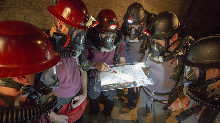 Doe Run's two mine rescue teams practicing their mine safety and rescue skills underground.