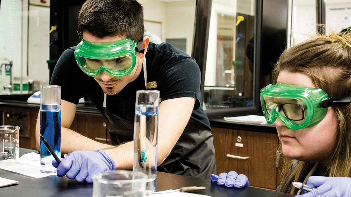Mineral Area College students working in a laboratory.