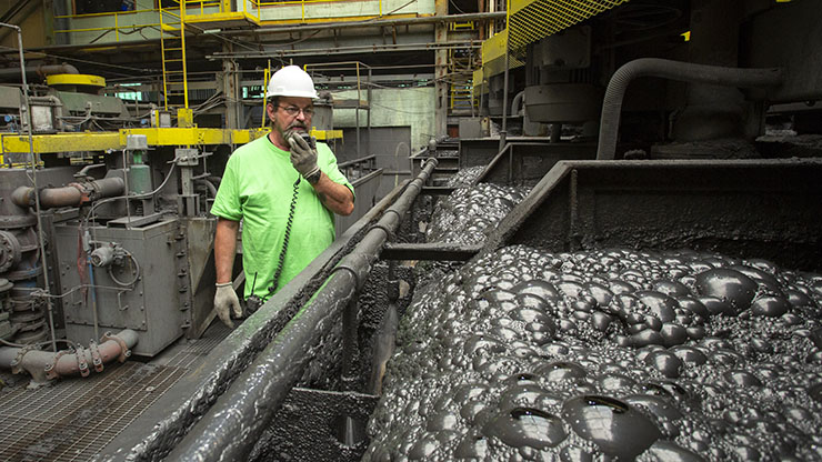 Employee oversees the floatation process at his milling job.